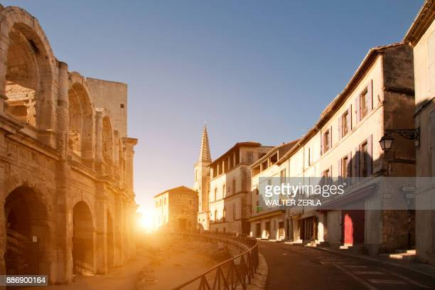 View of street and Arles Amphitheatre, Arles, Provence-Alpes-Cote dAzur, France