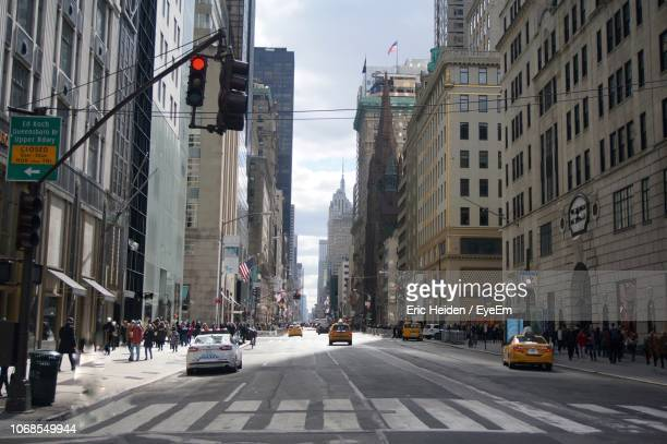 view of street and buildings in city - road signal stock pictures, royalty-free photos & images