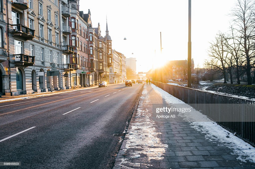 View of street by buildings during winter : Stock Photo