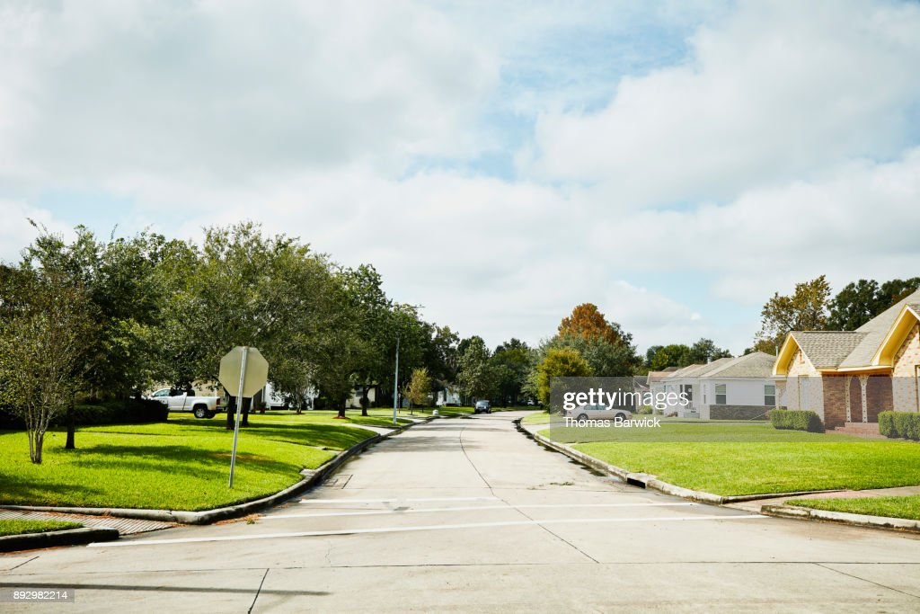 View of street in residential neighborhood on sunny afternoon : Stock Photo