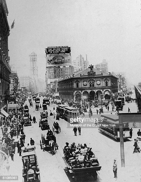 View of streetcars, traffic and pedestrians looking north from 34th Street and Broadway, Herald Square, New York City, circa 1909.