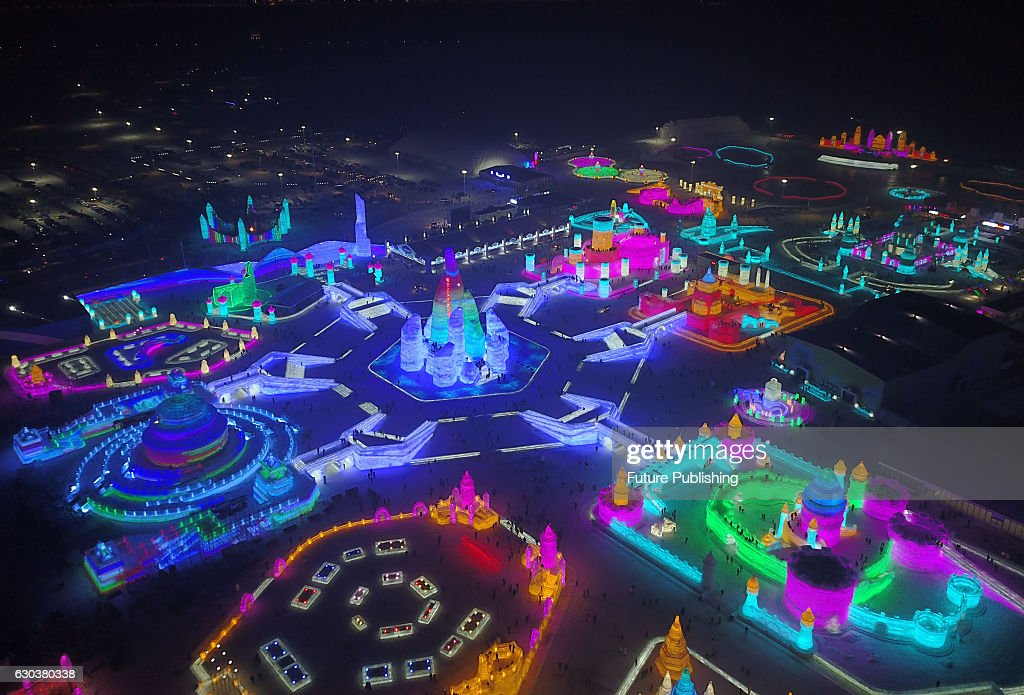 A view of structures built of ice during the opening night of the annual tourist attraction, Ice and Snow World, on December 21, 2016 in Harbin, China. Feature China / Barcroft Images hello@barcroftmedia.com - +1 212 796 2458 +91 11 4053 2429