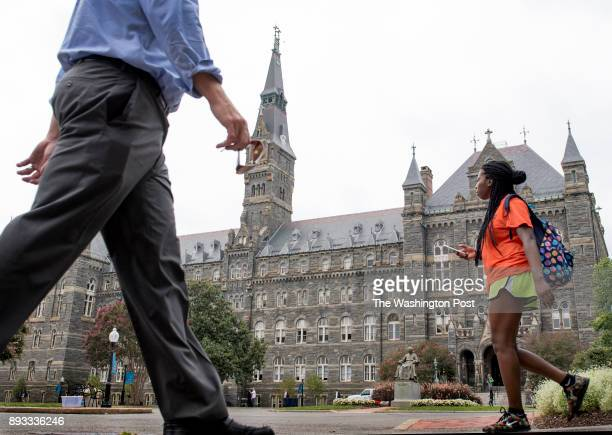 View of students staff parents around the iconic Healy Hall at Georgetown University as the school announces reparations it will make for the...