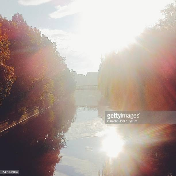 view of sun reflecting in water canal - danielle reid stock pictures, royalty-free photos & images