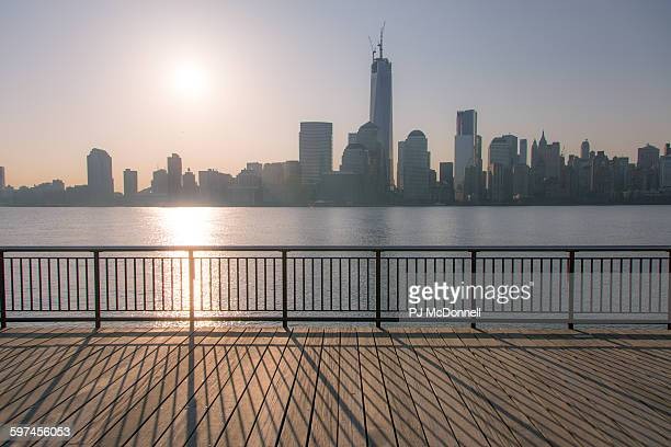 View of sun rising over lower Manhattan from Jersey City New Jersey