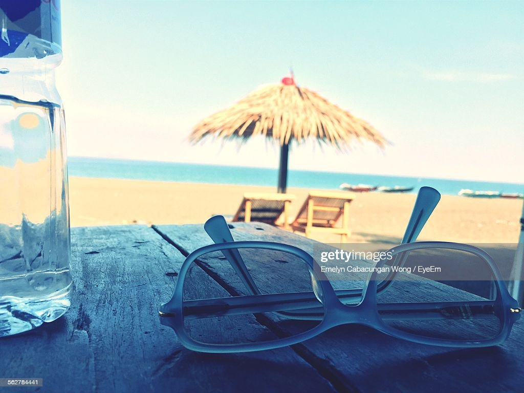 View Of Sunglasses With Bottle On Table At Beach Stock Foto Getty