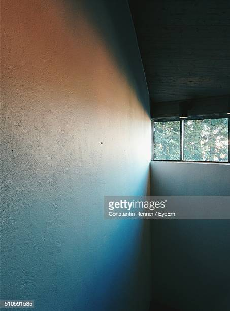 View of sunlight on white wall through window
