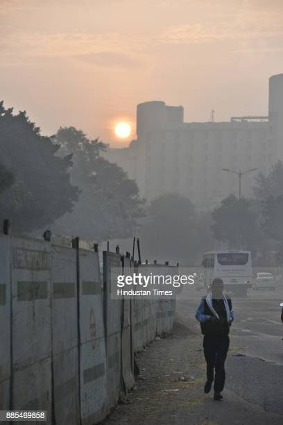 A view of sunrise during cold weather at Green Park on December 4 2017 in New Delhi India Air quality remained very poor with air quality index at...