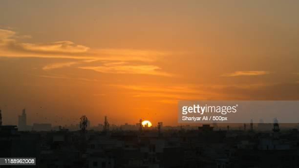 view of sunset above city, karachi, sindh, pakistan - パキスタン ストックフォトと画像