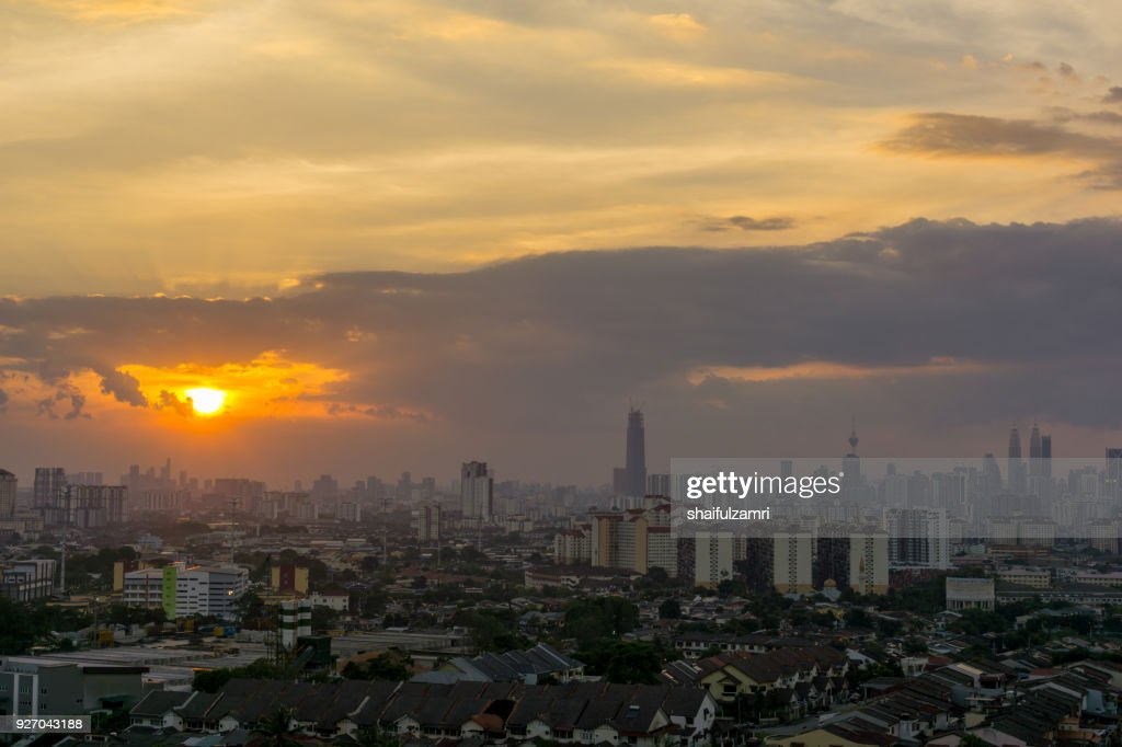 View of sunset at downtown Kuala Lumpur. Its modern skyline is dominated by the 451m tall Petronas Twin Towers, pair of of glass-and-steel-clad skyscraper. : Stock Photo