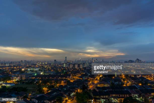 view of sunset at downtown kuala lumpur. its modern skyline is dominated by the 451m tall petronas twin towers, pair of of glass-and-steel-clad skyscraper. - shaifulzamri stock pictures, royalty-free photos & images