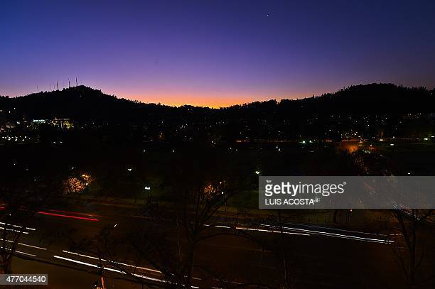 View of sunset in Santiago on June 13 during the Copa America 2015 AFP PHOTO/Luis Acosta