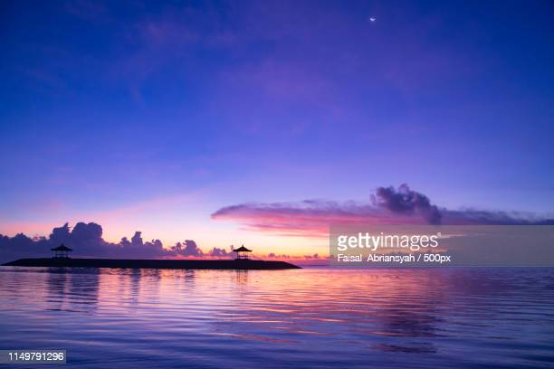 view of sunset over sea and submarine - submarine photos stock pictures, royalty-free photos & images
