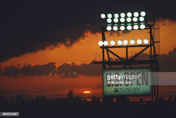 View of sunset over the skyline of Manhattan and New York with floodlights illuminating play inside the Louis Armstrong Stadium during the 1993 US...