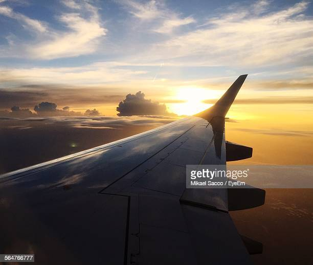 View Of Sunset Seen Through Airplane