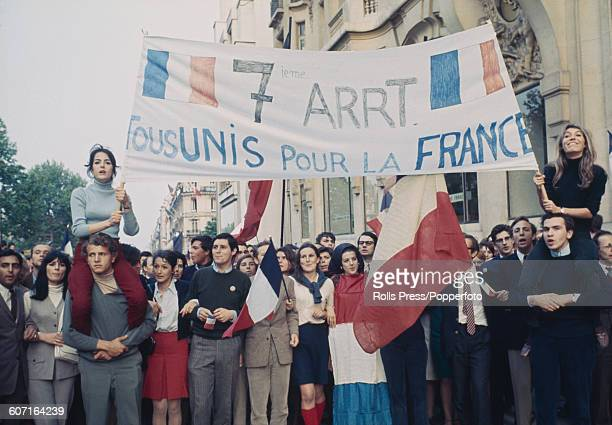 View of supporters of President Charles de Gaulle marching along the ChampsElysees in Paris in a show of solidarity with the President of the French...