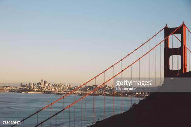 view of suspension bridge against sky - bortes stock photos and pictures