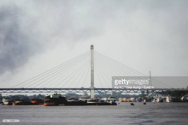 view of suspension bridge against sky - ko ko htike aung stock pictures, royalty-free photos & images