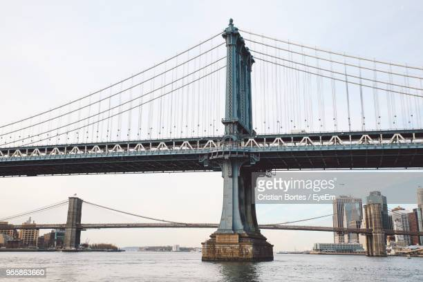 view of suspension bridge against sky - bortes stock-fotos und bilder