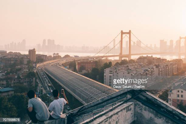 view of suspension bridge in city - wuhan stock photos and pictures