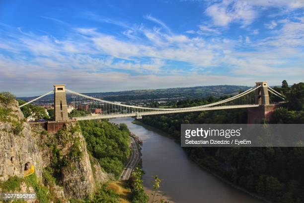 view of suspension bridge over river - bristol stock photos and pictures