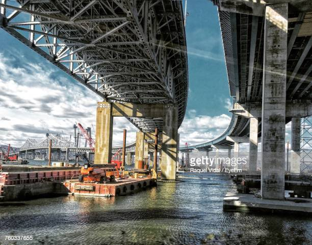 view of suspension bridge over river - tarrytown stock photos and pictures