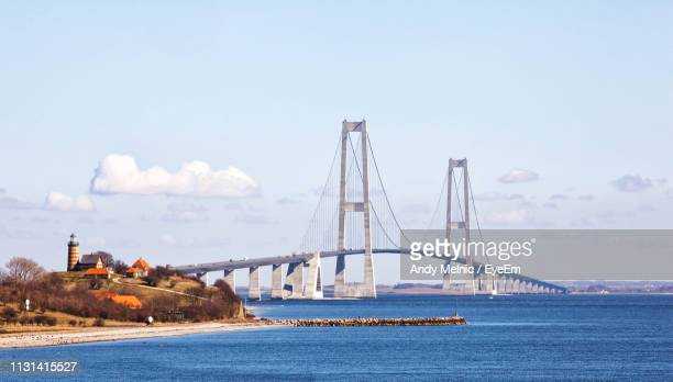 view of suspension bridge over sea - funen stock pictures, royalty-free photos & images