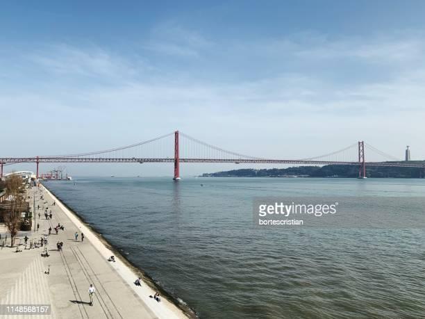 view of suspension bridge over sea - bortes foto e immagini stock