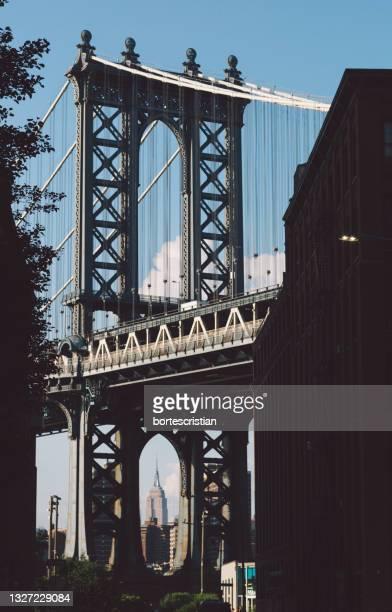view of suspension bridge - bortes stock pictures, royalty-free photos & images