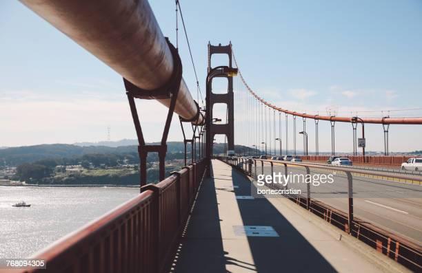 view of suspension bridge - bortes stockfoto's en -beelden