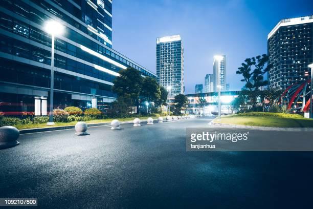 view of suzhou business plaza at night - büropark stock-fotos und bilder