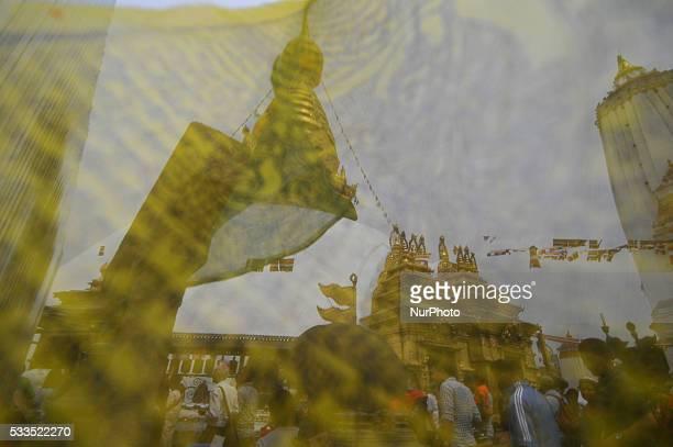 A View of Swayambhunath Stupa a monkey temple as ritual flag flies during celebration the 2560th Buddha Purnima festival Birth Anniversary of Lord...