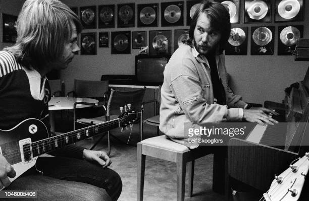 View of Swedish Pop musicians Bjorn Ulvaeus and Benny Andersson, both of the group ABBA, as they practice in the studio that they co-founded, Polar...