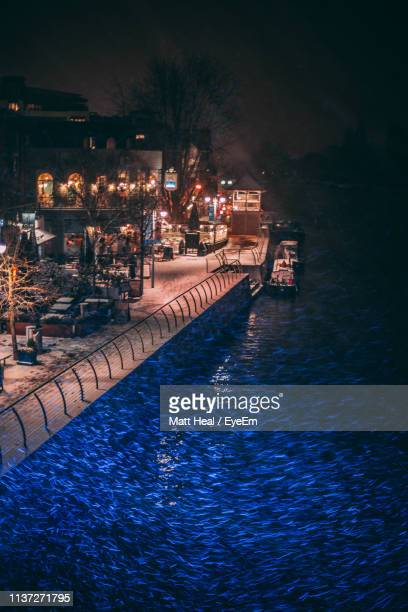 view of swimming pool at night - kingston upon thames stock pictures, royalty-free photos & images