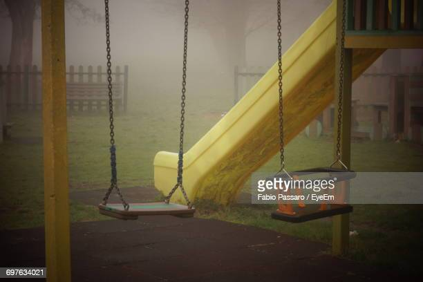 view of swings - wet stock pictures, royalty-free photos & images
