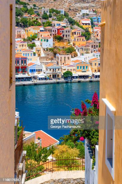 view of symi between houses - symi foto e immagini stock
