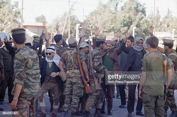 View of Syrian Arab men surrendering and being taken captive as prisoners by members of the Israeli Defense Forces in the Quneitra district of Syria...