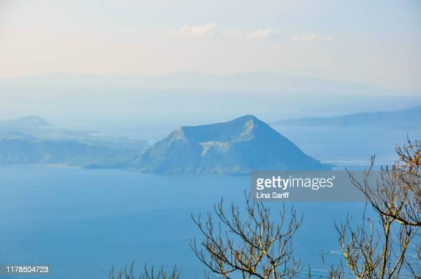 view of taal volcano in tagaytay city in philippines. blurred and unclear atmostphere during hazy day. - taal volcano stock photos and pictures