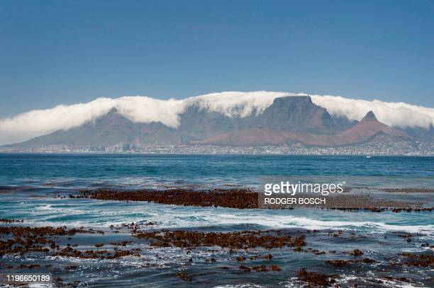 A view of Table Mountain covered with clouds and the city of Cape Town below taken from Robben Island where Nelson Mandela an antiapartheid...