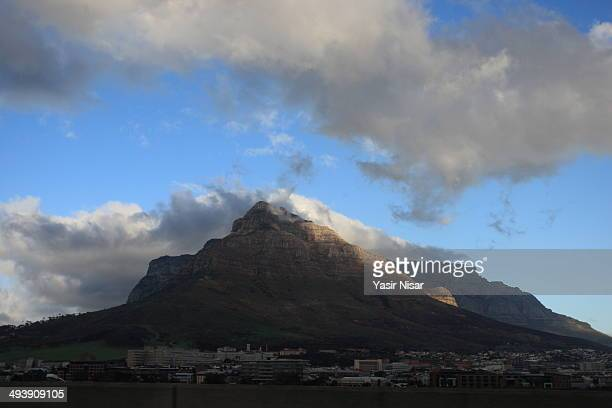a view of table mountain with clouds - yasir nisar stock photos and pictures