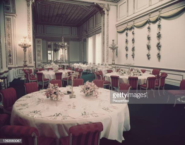 View of tables laid out for a state dinner in the banqueting hall at Lancaster House in St James's London in July 1953