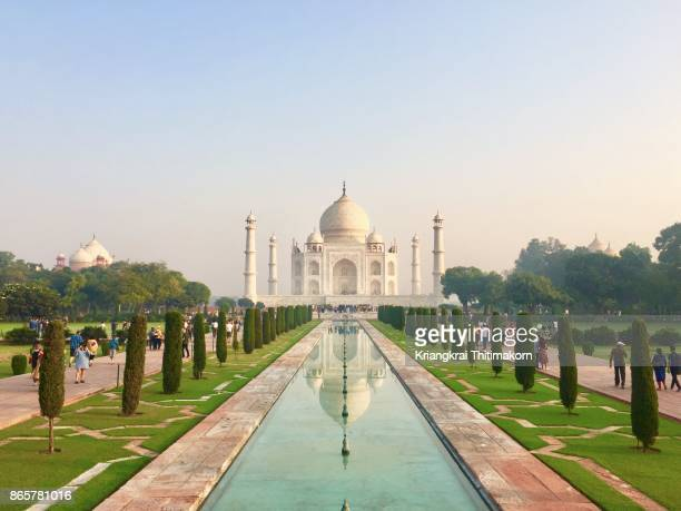 view of taj mahal during sunrise time, agra, india. - taj mahal stock photos and pictures