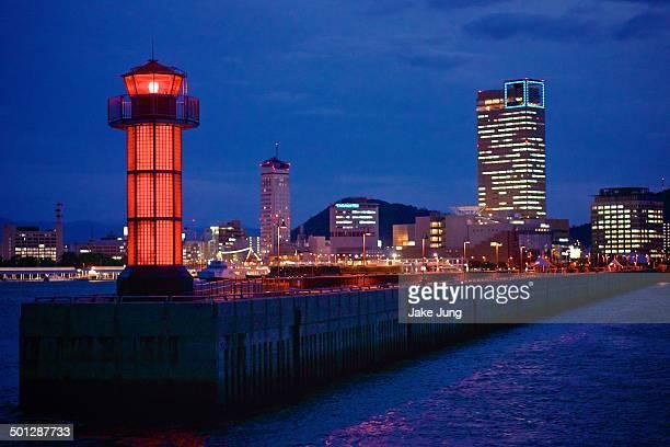 view of takamatsu bay lighthouse and buildings - kagawa ストックフォトと画像