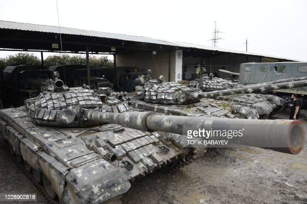 View of tanks which Azeri army officials said were seized during the ongoing fighting with Armenia over the breakaway Nagorno-Karabakh region, in the...
