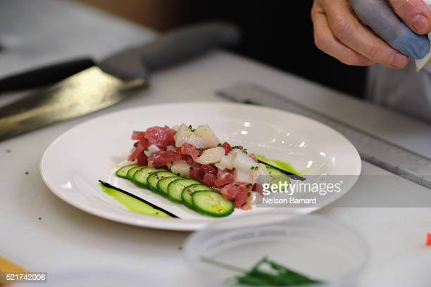 View of tartare of yellowfin tuna and diver scallops seasoned with American Caviar finished dish during Chef Gabriel Kreuther's Signature Dishes...