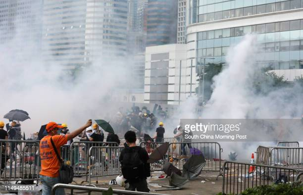 View of tear gas being used to disperse the antiextradition bill protestors near the Legislative Council Complex on June 12 2019 in Tamar Hong Kong...