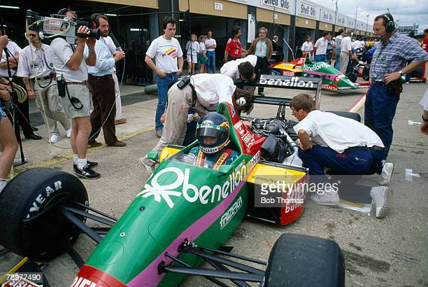 View of technical staff and mechanics working on the Benetton Formula Ltd Benetton B187 Ford Cosworth GBA 15 V6t car of Belgian racing driver Thierry...