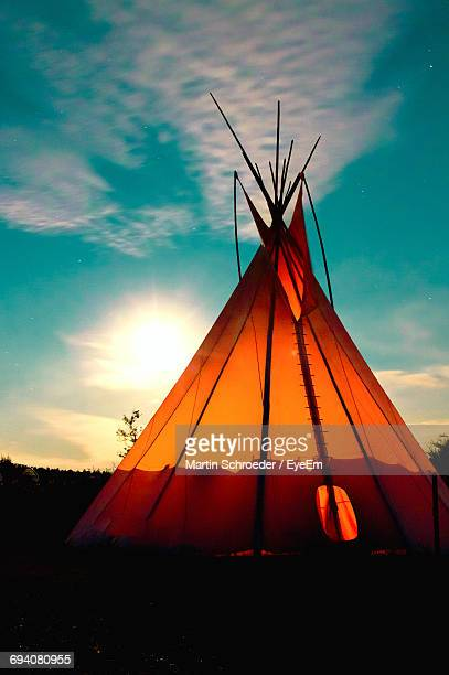 View Of Teepee Against Sky At Sunset
