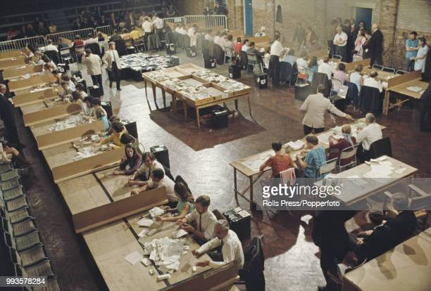 View of tellers counting votes from ballot boxes in a community hall in Bexley constituency in Kent during the 1970 United Kingdom general election...