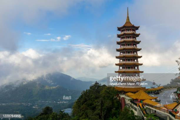 view of temple against cloudy sky - shaifulzamri stock pictures, royalty-free photos & images